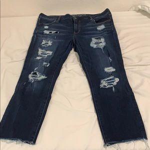 Cropped dark wash ripped jean
